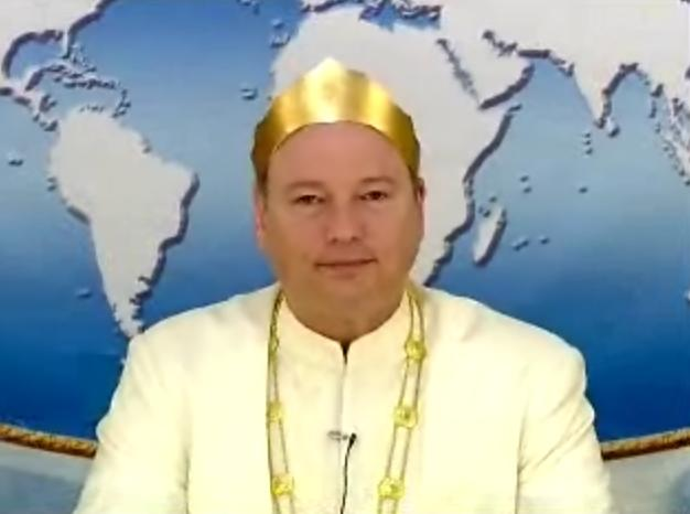 Physicist John Hagelin wearing his white robe and golden crown